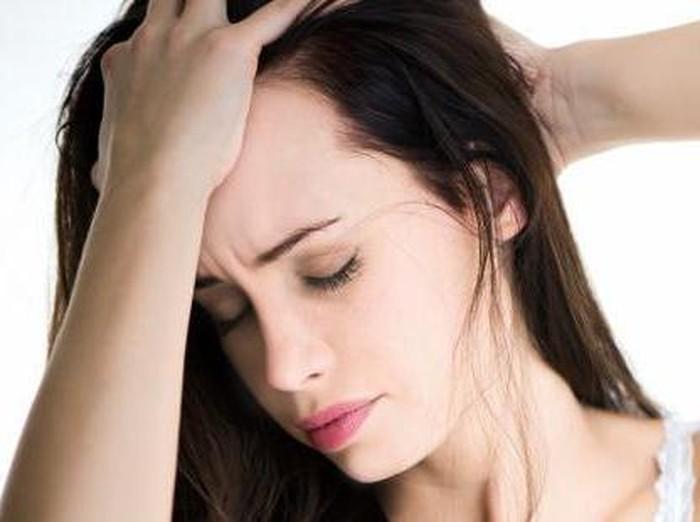 Ilustrasi wanita sakit kepala/Foto: thinkstock