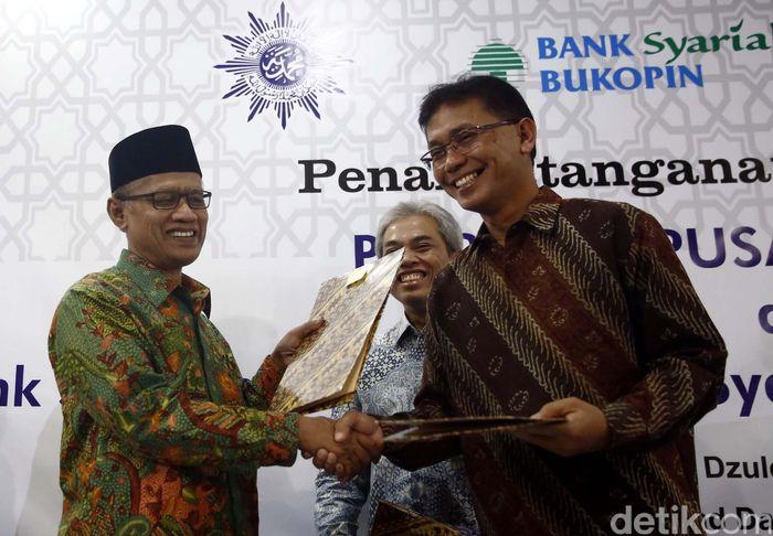 Penandatanganan MoU dilakukan oleh Ketua Umum PP Muhammadiyah, Dr. H. Haedar Nashir, M.Si dengan Riyanto Direktur Utama BSB di Kantor PP Muhammadiyah Jakarta, Jumat (5/8/2016).