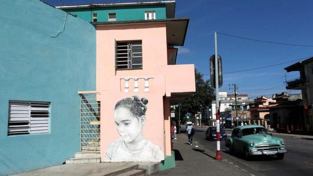 Dinding Kota Havana Dihiasi Mural Anak Bermata Lebar
