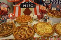 Di Gerai Pizza Asal Ini Bisa Nikmati Pizza Potongan dengan Topping Pilihan