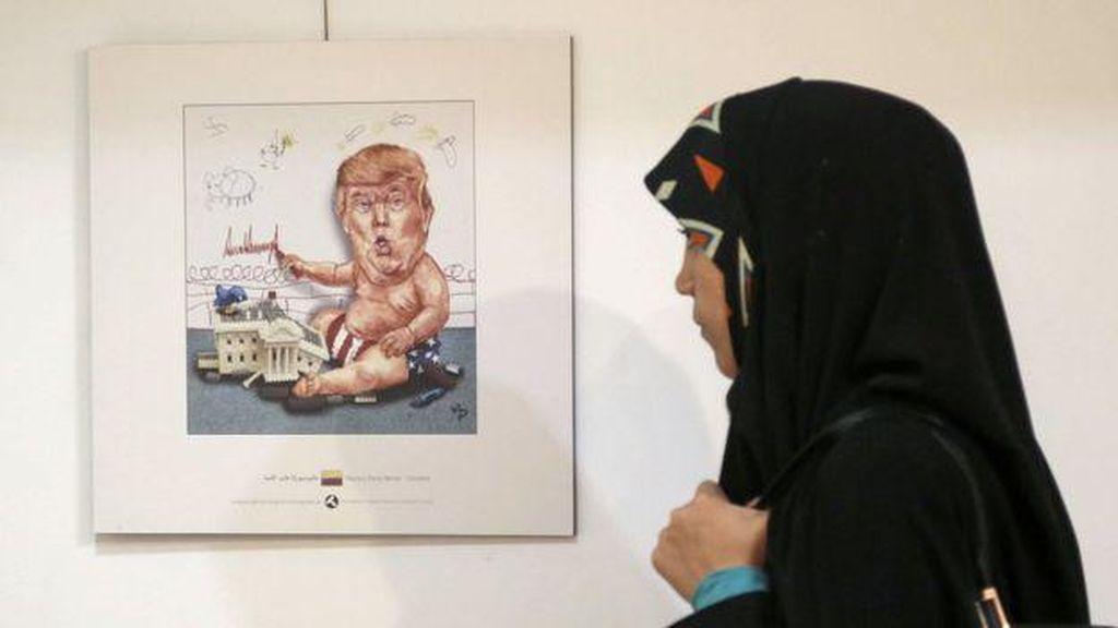 Ratusan Kartunis Dunia Kritik Donald Trump Lewat Kartun