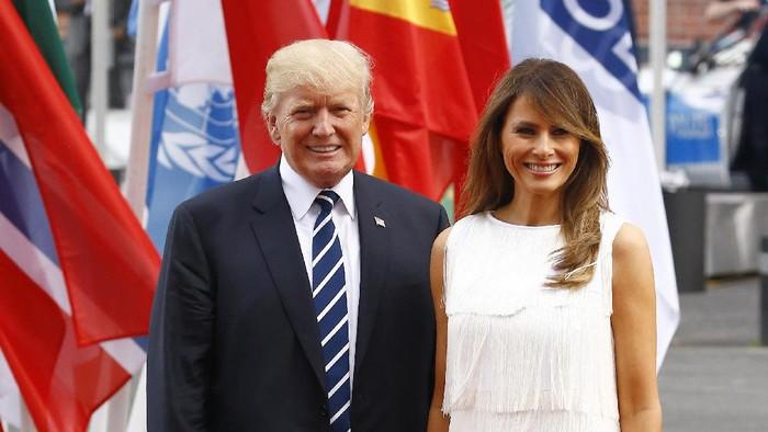 Donald Trump dan istri. Foto: Morris MacMatzen/Getty Images