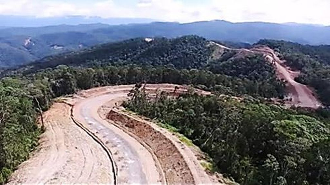 Foto: Mau Lihat Jalan Trans Papua Dibangun? Nih Foto-fotonya