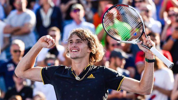 Zverev merayakan kemenangannya atas Federer.