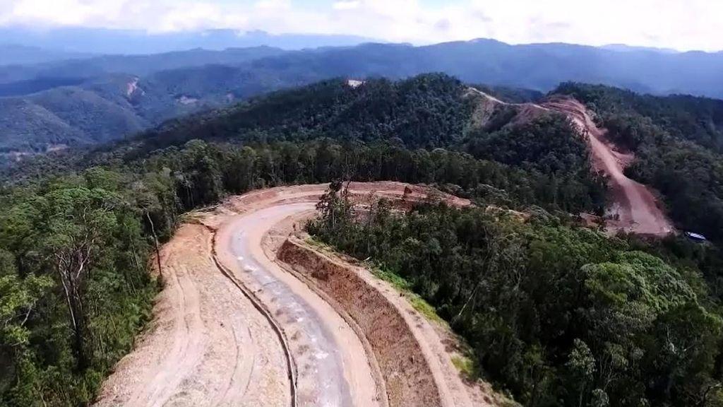 Begini Jalan Trans Papua Dibangun Hingga Mulus