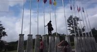 Hikmat saat membetulkan bendera yang terbalik /