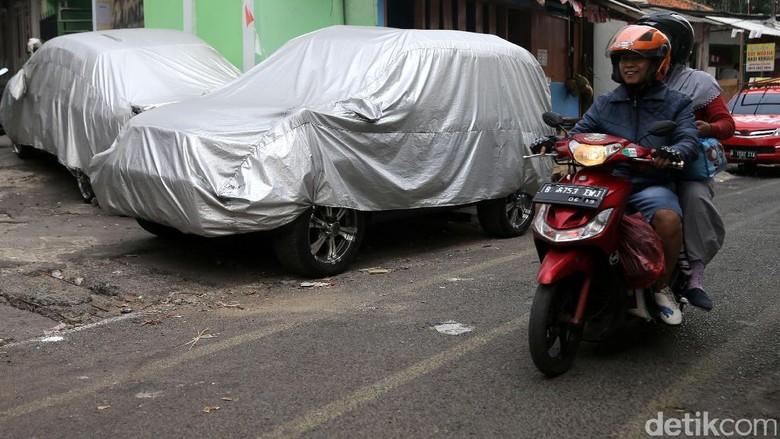 Pemprov DKI Gandeng TNI -Polri Tertibkan Mobil Warga di Perumahan