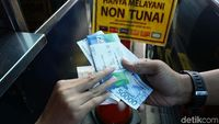 Benarkah Transaksi Pakai e-Money Melanggar Undang-undang?