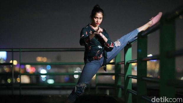 Aghniny Haque belum mau dibilang pensiun dari taekwondo.