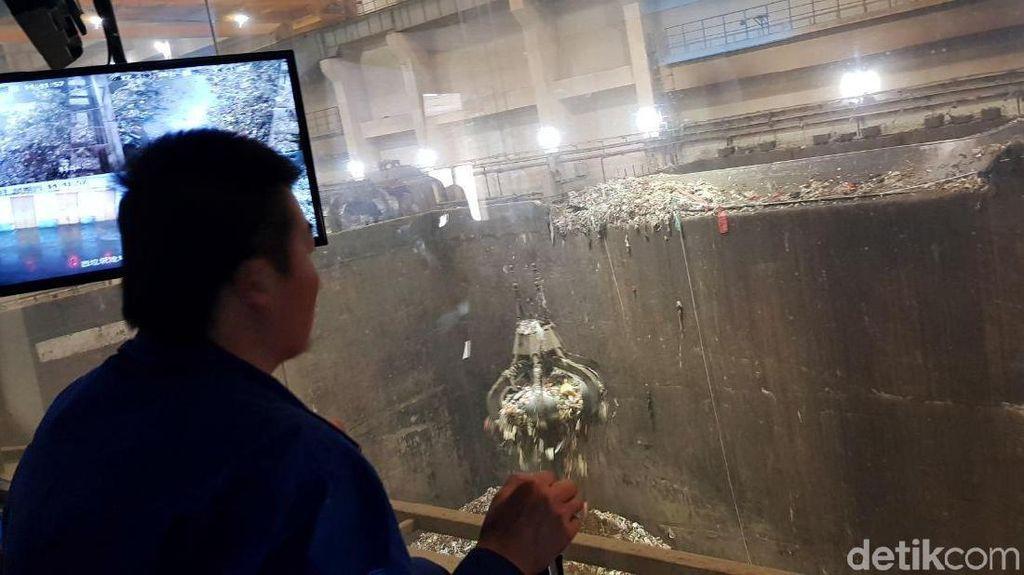 Foto: Begini Cara China Olah Tumpukan Sampah Jadi Listrik