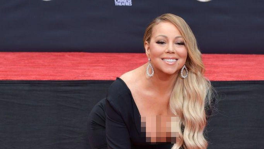 Mariah Carey Rela Mengotori Tangan & Sepatu Mahalnya dengan Semen, untuk Apa?
