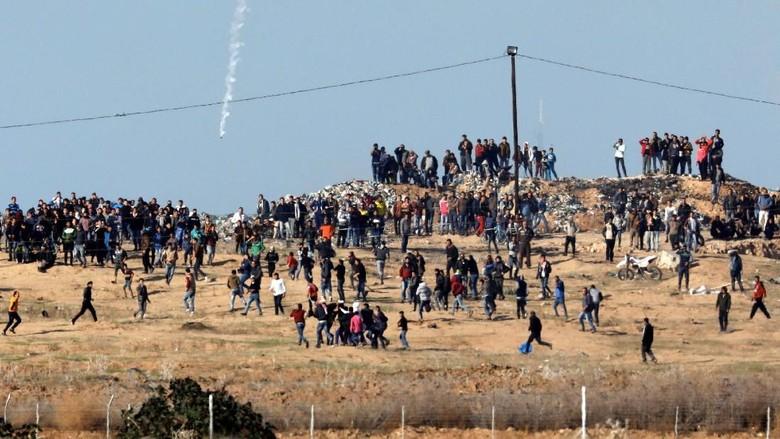 Warga Palestina Tewas dalam Aksi - Gaza City Sedikitnya dua warga Palestina tewas dalam bentrokan dengan tentara saat memprotes keputusan Presiden Amerika Serikat Donald