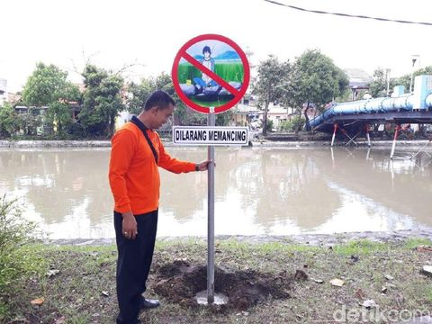 Rambu dilarang memancing/