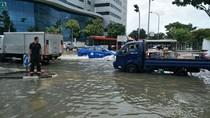 Foto: Banjir Landa Singapura Usai Hujan Deras