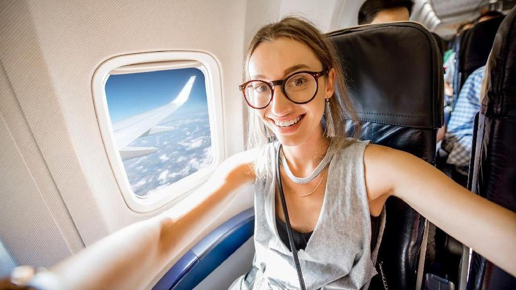 7 Tips Anti Bosan di Pesawat