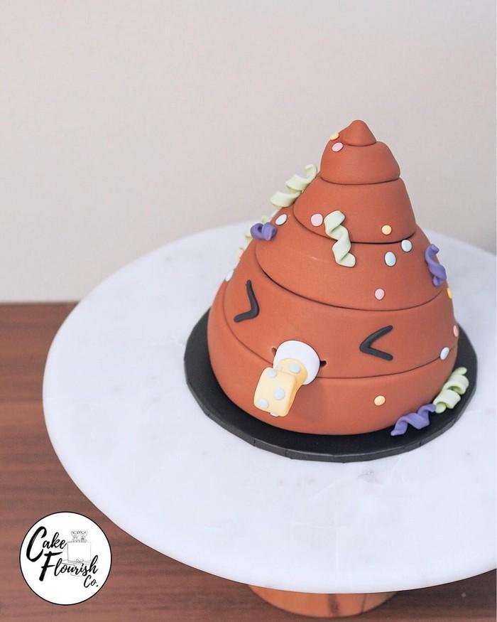 Kue dengan tema poop ini menggemaskan. Akun Instagram @cakeflourischco menyebut kue ini Party Pooper. Jadi kue bentuk poop lucu ini sedang berpesta. Lucu juga! Foto: Istimewa
