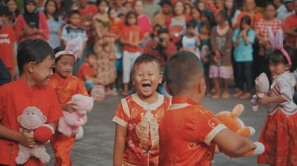 Red vibe in the laughter of children