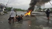 Marah Akibat Polusi, Warga Bakar Properti dan Lempari Bangunan PT RUM