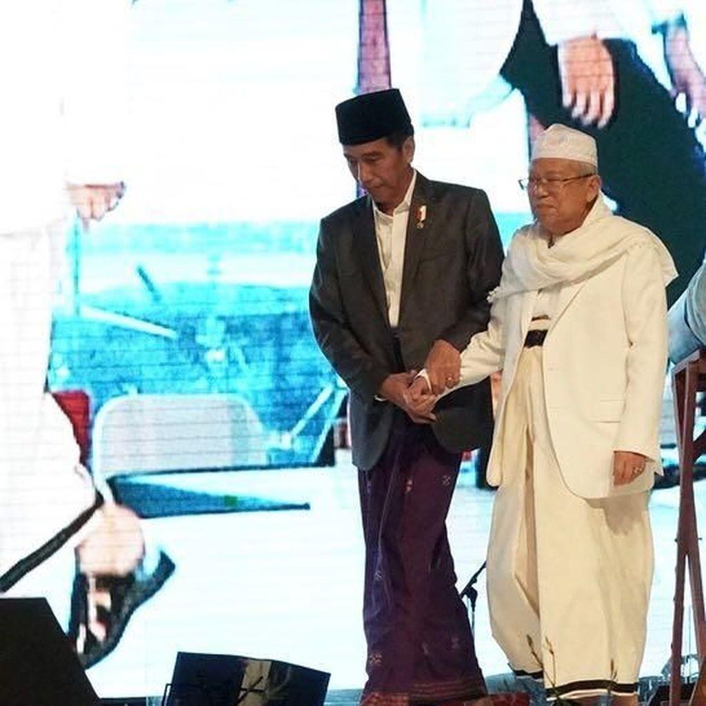 Melihat Momen Jokowi Genggam Erat Maruf Amin di Festival Sholawat