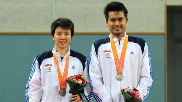 Tontowi Ahmad/Liliyana Natsir saat tampil di Asian Games 2014 Incheon.