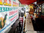 Duh! Pembatas Jalan di Kawasan Sudirman Jadi Meja Dadakan PKL