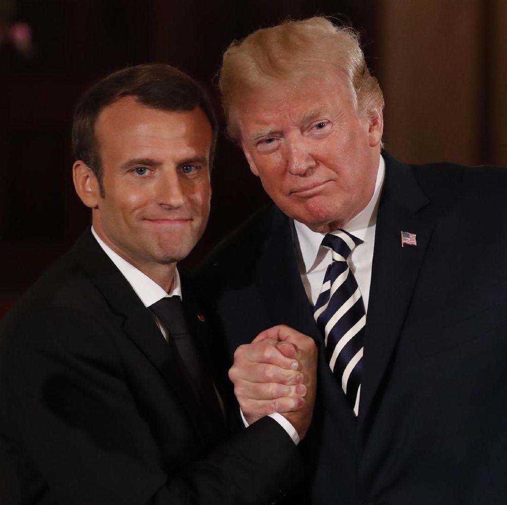Hangatnya Trump dan Macron, Gandengan Tangan dan Cipika-cipiki