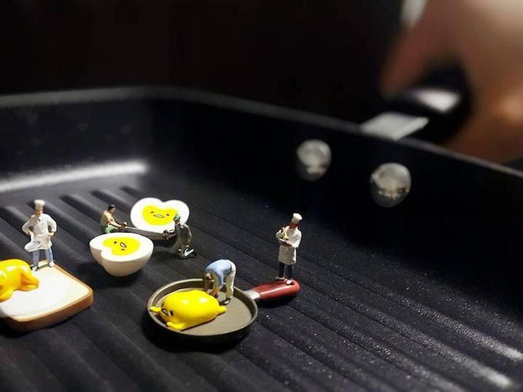 Kreatif! Desainer Ini Rangkai Miniatur Orang dan Makanan sebagai Karya Fotonya