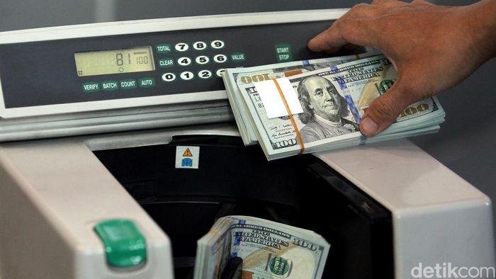 Pelemahan nilai tukar rupiah terhadap dolar Amerika Serikat (AS) semakin tajam, Selasa (16/12/2014). Saat ini, dolar AS sudah mendekati level Rp 12.900.