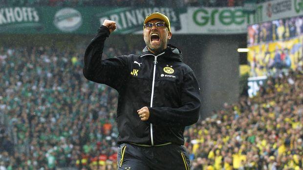 Juergen Klopp bawan Dortmund juara Bundesliga.