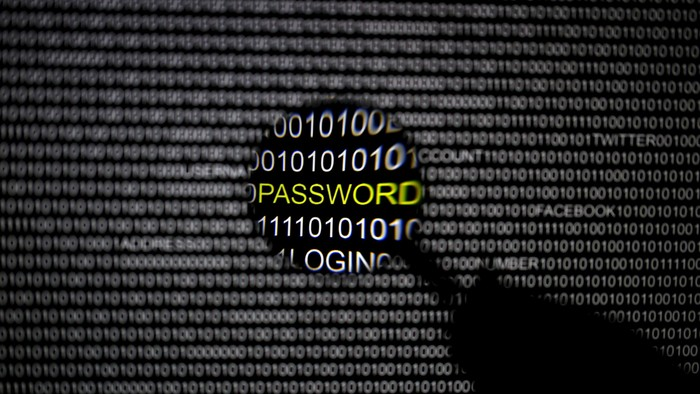 A magnifying glass is held in front of a computer screen in this file picture illustration taken in Berlin May 21, 2013. Hackers broke into U.S. government computers, possibly compromising the personal data of 4 million current and former federal employees, and investigators were probing whether the culprits were based in China, U.S. officials said on June 4, 2015. REUTERS/Pawel Kopczynski/Files
