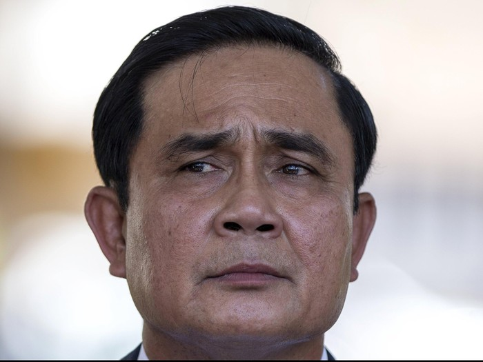 Thailands Prime Minister Prayuth Chan-ocha listens to a question from a journalist after a ceremony to mark the National Anti Human Trafficking Day at Government House in Bangkok, Thailand, June 5, 2015.   REUTERS/Athit Perawongmetha