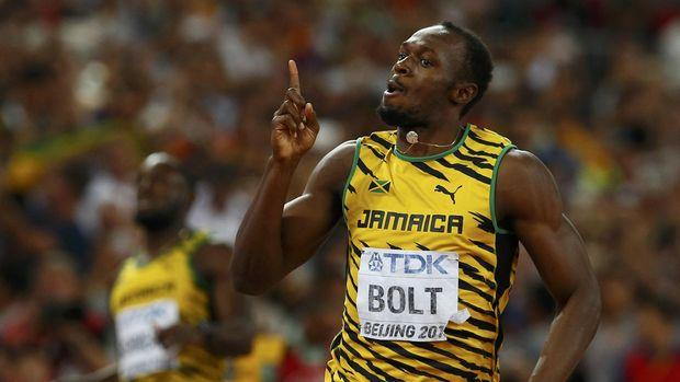 Bolt saat meraih medali emas di nomor 200 meter Olimpiade 2008 Beijing. (