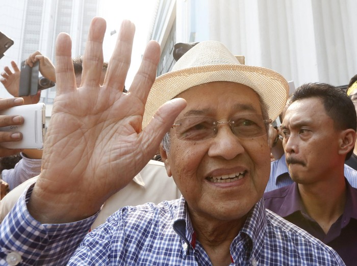 Former Malaysian Prime Minister Mahathir Mohamad speaks to the media during a rally organised by pro-democracy group