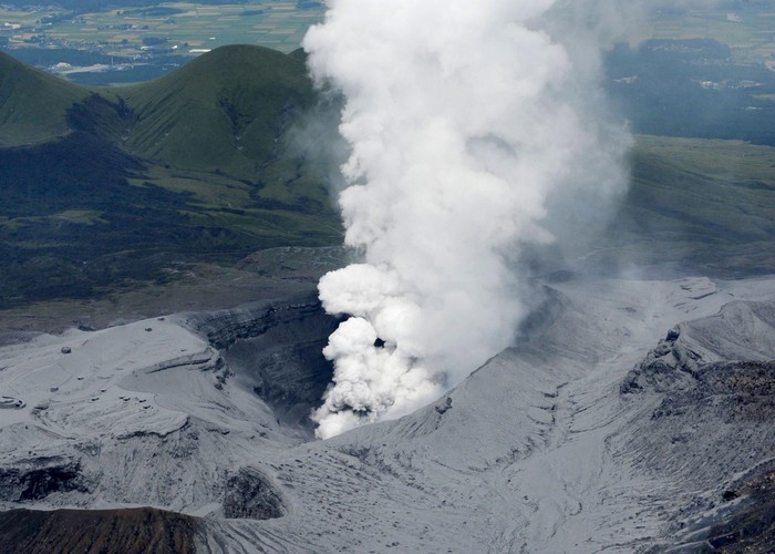 An aerial view shows an eruption of Mount Aso in Aso, Kumamoto prefecture, southwestern Japan, in this photo taken by Kyodo September 14, 2015. Mount Aso, a volcano on Japans main southern island of Kyushu, erupted on Monday, Japans Meteorological Agency said, blasting a plume of black smoke 2 km (1.2 miles) high, but there were no immediate reports of damage or injuries. Mandatory credit. REUTERS/KyodoATTENTION EDITORS - THIS PICTURE WAS PROVIDED BY A THIRD PARTY. REUTERS IS UNABLE TO INDEPENDENTLY VERIFY THE AUTHENTICITY, CONTENT, LOCATION OR DATE OF THIS IMAGE. FOR EDITORIAL USE ONLY. NOT FOR SALE FOR MARKETING OR ADVERTISING CAMPAIGNS. MANDATORY CREDIT. JAPAN OUT. NO COMMERCIAL OR EDITORIAL SALES IN JAPAN.  THIS IMAGE WAS PROCESSED BY REUTERS TO ENHANCE QUALITY, AN UNPROCESSED VERSION WILL BE PROVIDED SEPARATELY.      TPX IMAGES OF THE DAY