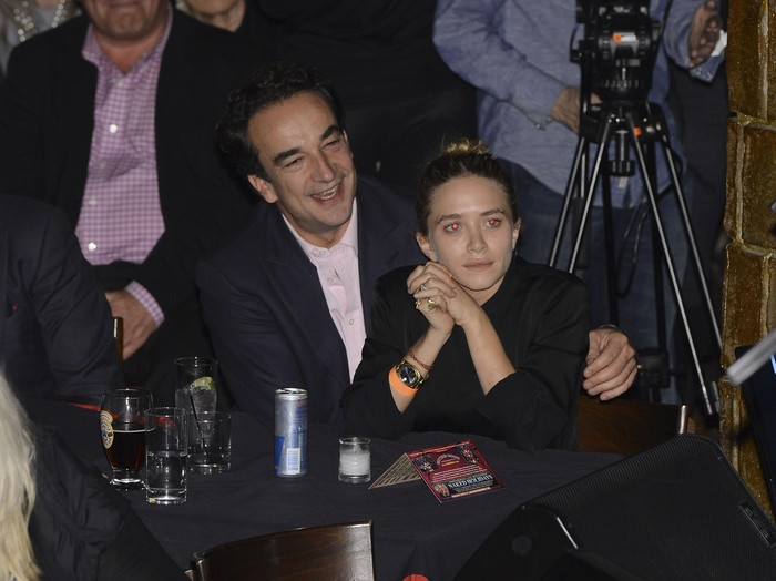 NEW YORK, NY - NOVEMBER 07:  Olivier Sarkosy and Mary Kate Olsen attend performance of Ronnie Wood And Mick Taylor With Special Guests at The Cutting Room on November 7, 2013 in New York City.  Ronnie Wood of the Rolling Stones made a rare club appearance at New York?s premiere music venue and nightclub, The Cutting Room.  Ronnie was performing the music of Jimmy Reed.  Musical icons  Mick Taylor, Al Cooper, Simon Kirk, Gary Clark Jr. and others joined him on stage.  (Photo by Larry Busacca/Getty Images)
