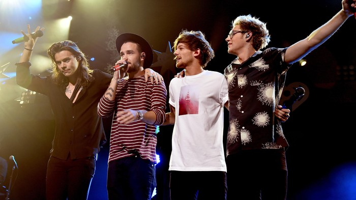 DALLAS, TX - DECEMBER 01:  (L-R) Singers Harry Styles, Liam Payne, Louis Tomlinson and Niall Horan of musical group One Direction perform onstage during 106.1 KISS FMs Jingle Ball 2015 presented by Capital One at American Airlines Center on December 1, 2015 in Dallas, Texas.  (Photo by Kevin Winter/Getty Images for iHeartMedia)