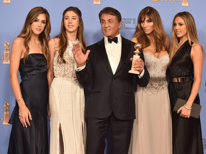 LOS ANGELES, CA - FEBRUARY 10:  Actor Sylvester Stallone (center) and his daughters Sistine Stallone (L) and Sophia Stallone (R) attend Saint Laurent at the Palladium on February 10, 2016 in Los Angeles, California for the Saint Laurent Los Angeles show.  (Photo by Larry Busacca/Getty Images for SAINT LAURENT)