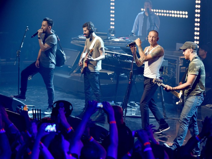 BURBANK, CA - JUNE 18:  Musical group Linkin Park onstage during the iHeartRadio album release party with Linkin Park presented by Clear Channel at the iHeartRadio Theater on June 18, 2014 in Burbank, California.  (Photo by Kevin Winter/Getty Images for Clear Channel)