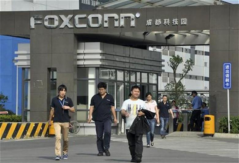 Apple dan Amazon paling menjadi sorotan dalam kerja sama dengan Foxconn. Keduanya yang terbanyak menggunakan tenaga buruh Foxconn merakit gadget mereka. Foto: Getty Images