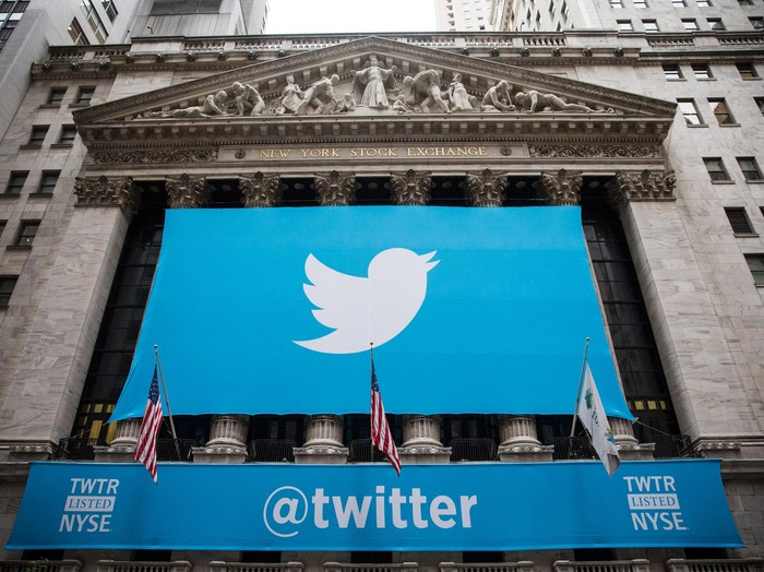 NEW YORK, NY - NOVEMBER 07:  The Twitter logo is displayed on a banner outside the New York Stock Exchange (NYSE) on November 7, 2013 in New York City. Twitter goes public on the NYSE today and is expected to open at USD 26 per share, making the company worth an estimated USD 18 billion.  (Photo by Andrew Burton/Getty Images)