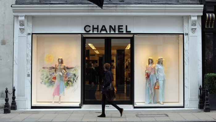 LONDON, ENGLAND - JANUARY 24:  A person walks by the Chanel store on Bond Street on January 24, 2011 in London, England. Despite the expected retail slump, sales of luxury goods are booming, with many companies posting large profits.  (Photo by Dan Kitwood/Getty Images)