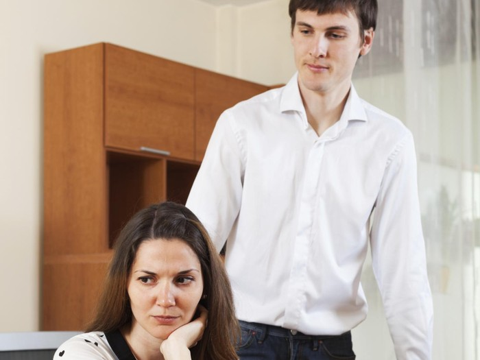 Unhappy girl conflicting with boyfriend