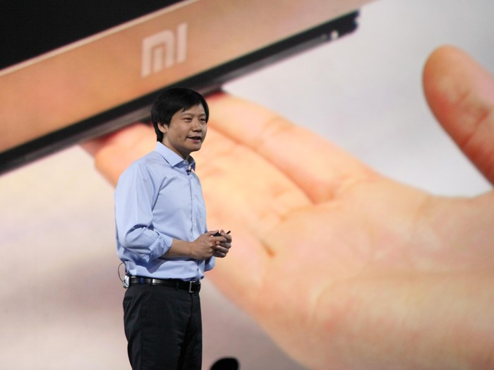 BEIJING, CHINA - MAY 15:  (CHINA OUT) Xiaomi CEO Lei Jun speaks during a product launch on May 15, 2014 in Beijing, China. Privately owned Chinese electronics company Xiaomi has lauched its first tablet and low-price 4K TV on Thursday. The newly launched
