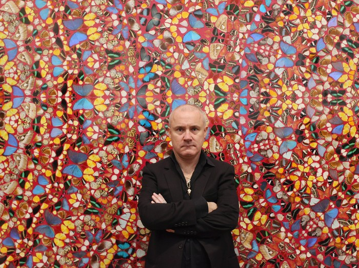 LONDON, ENGLAND - APRIL 02:  Artist Damien Hirst poses in front of his artwork entitled I am Become Death, Shatterer of Worlds in the Tate Modern art gallery on April 2, 2012 in London, England. The Tate Modern is displaying the first major exhibition of Damien Hirsts artworks in the UK, bringing together the collection over 70 of Hirsts works spanning three decades. The exhibition opens to the general public on April 4, 2012 and runs until September 9, 2012.  (Photo by Oli Scarff/Getty Images)