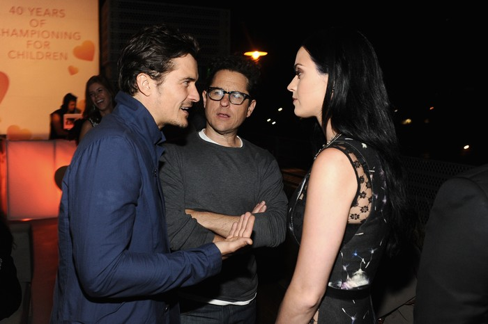 SANTA MONICA, CA - APRIL 10:  (L-R) Actor Orlando Bloom, host J.J. Abrams, and singer Katy Perry attend Coach's 3rd Annual Evening of Cocktails and Shopping to Benefit the Children's Defense Fund hosted by Katie McGrath, J.J. Abrams and Bryan Burk at Bad Robot on April 10, 2013 in Santa Monica, California.  (Photo by Stefanie Keenan/Getty Images for Coach)
