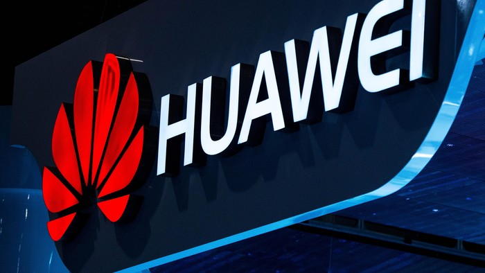 BARCELONA, SPAIN - MARCH 03:  A logo sits illuminated outside the Huawei pavilion during the second day of the Mobile World Congress 2015 at the Fira Gran Via complex on March 3, 2015 in Barcelona, Spain. The annual Mobile World Congress hosts some of the wolds largest communication companies, with many unveiling their latest phones and wearables gadgets.  (Photo by David Ramos/Getty Images)