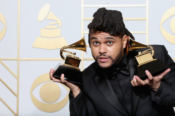 LOS ANGELES, CA - FEBRUARY 15:  Musician The Weeknd, winner of the awards for Best R&B Performance for Cant Feel My Face and Best Urban Contemporary album for Beauty Behind the Madness, poses in the press room during The 58th GRAMMY Awards at Staples Center on February 15, 2016 in Los Angeles, California.  (Photo by Frederick M. Brown/Getty Images for NARAS)