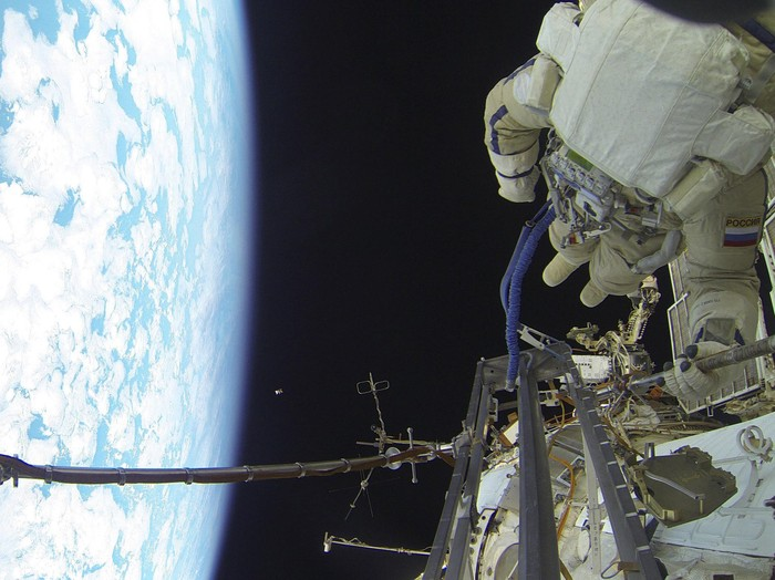 International Space Station (ISS) expedition 46/47 crew member, Russian cosmonaut Sergei Volkov performs a spacewalk outside the ISS in this Roscosmos image released on February 7, 2016. REUTERS/Roscosmos/Handout via Reuters ATTENTION EDITORS - THIS PICTURE WAS PROVIDED BY A THIRD PARTY. REUTERS IS UNABLE TO INDEPENDENTLY VERIFY THE AUTHENTICITY, CONTENT, LOCATION OR DATE OF THIS IMAGE. FOR EDITORIAL USE ONLY. NOT FOR SALE FOR MARKETING OR ADVERTISING CAMPAIGNS. FOR EDITORIAL USE ONLY. NO RESALES. NO ARCHIVE. THIS PICTURE IS DISTRIBUTED EXACTLY AS RECEIVED BY REUTERS, AS A SERVICE TO CLIENTS.