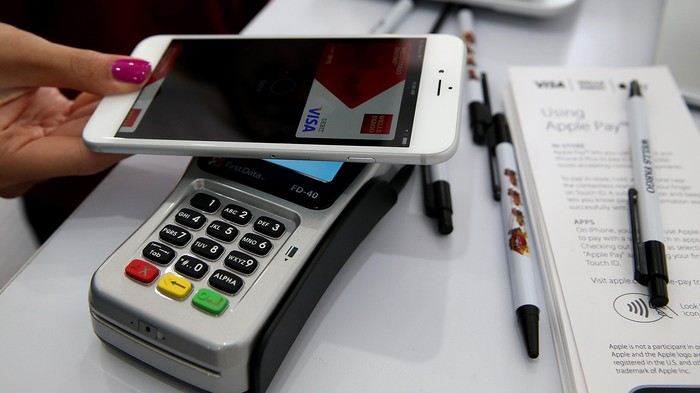 SAN FRANCISCO, CA - OCTOBER 20:  The Apple Pay logo is displayed in a mobile kiosk sponsored by Visa and Wells Fargo to demonstrate the new Apple Pay mobile payment system on October 20, 2014 in San Francisco City. Apples Apple Pay mobile payment system launched today at select banks and retail outlets. (Photo by Justin Sullivan/Getty Images)