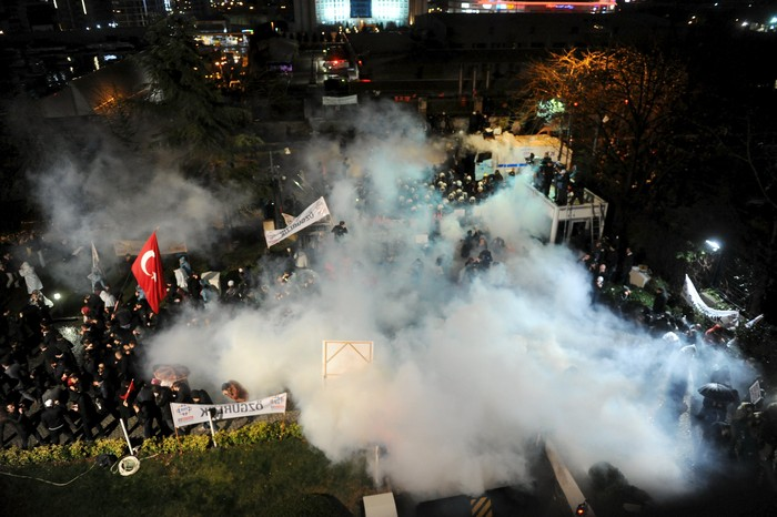 Riot police use tear gas to disperse protesting employees and supporters of Zaman newspaper at the courtyard of the newspapers office in Istanbul, Turkey, late March 4, 2016. Turkish authorities seized control of the countrys largest newspaper on Friday in a widening crackdown against supporters of U.S.-based Muslim cleric Fethullah Gulen, an influential foe of President Tayyip Erdogan. REUTERS/Selahattin Sevi /Zaman Daily EDITORIAL USE ONLY. NO RESALES. NO ARCHIVE